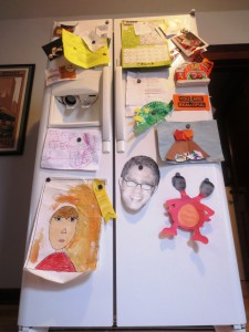 This refrigerator is in danger of toppling over with the weight of family artwork.