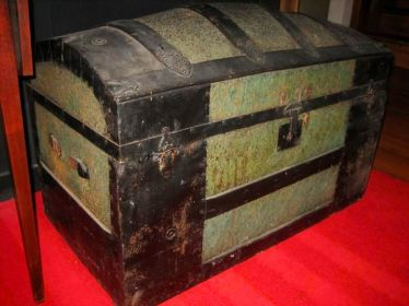 """Antique"" means this trunk hasn't been opened in 90 years, because early 20th Century humans couldn't life it. Are you feeling lucky?"